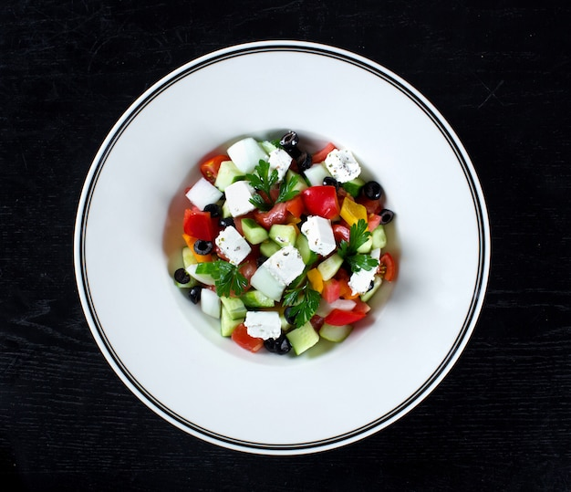 Greek salad with olives and bell pepper