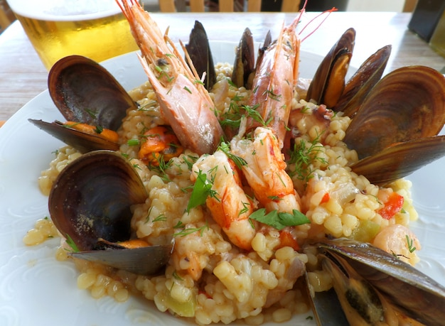 Greek style seafood trachanotto (frumenty) with mussels and shrimps