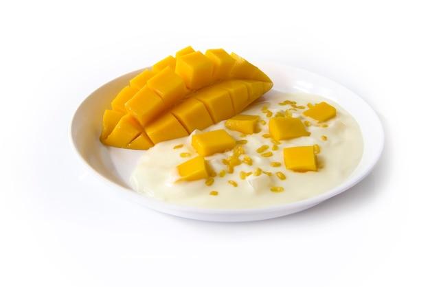 Greek yogurt original flavour with fresh cutting thai mango on the white plate