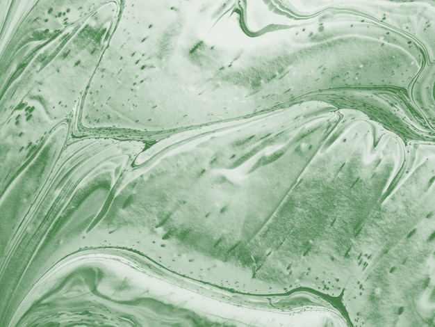 Green abstract background made with fluid art technique.