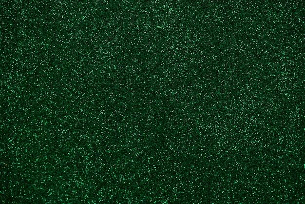 Зеленый абстрактный фон огней. зеленый блеск. зеленый фон для дизайнеров блестящий