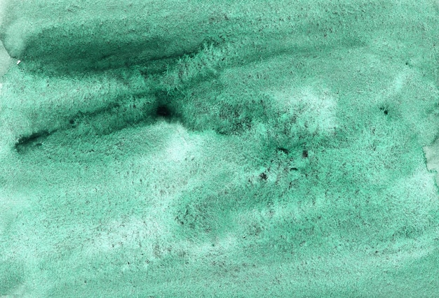 テクスチャードペーパー上の緑の抽象的な水彩画の背景