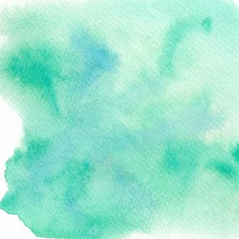 緑色の抽象的な水彩の背景。