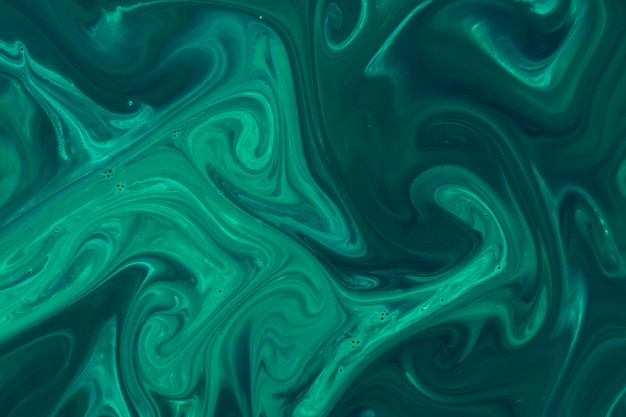 Green acrylic paint on water surface background