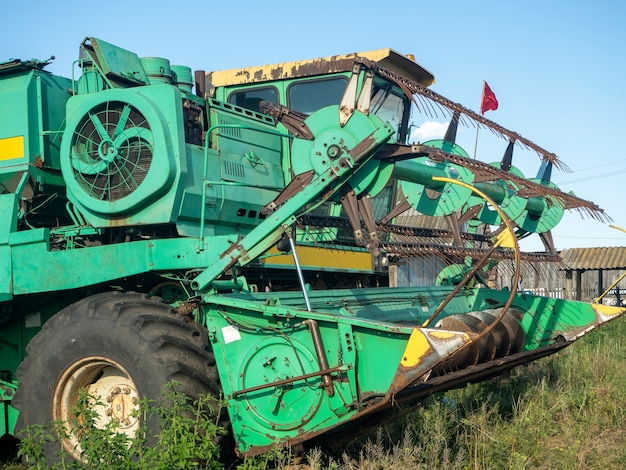 Green agricultural harvester. agricultural machinery for harvesting.
