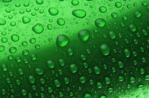 Green aluminum can with water drops or dew close-up