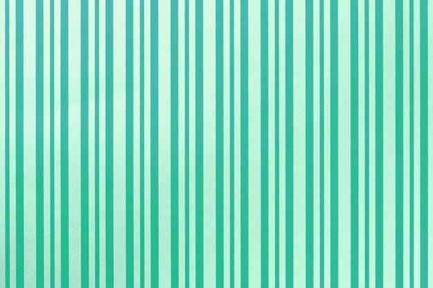 縞模様の紙の包装から緑とターコイズブルーの背景。