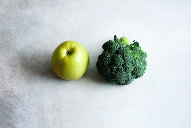 Green apple and broccoli. clean detox eating, vegetarian, vegan, raw concept. copy space