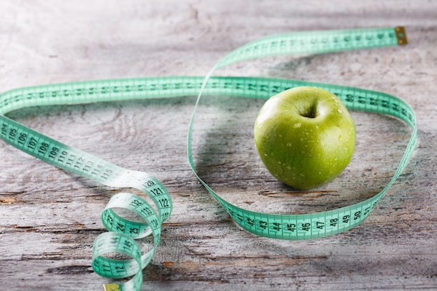 Green apple and centimetre.food or healthy diet concept
