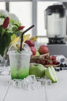 Green apple italian soda arranged on wood table
