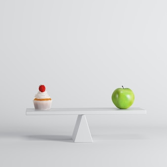 Green apple seesaw with green apple on opposite end on white background.