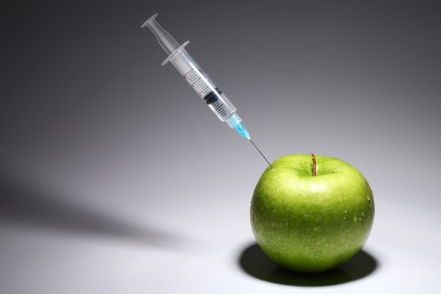 Green apple and syringe
