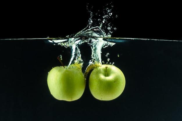 Green apple under water