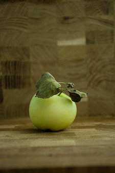Green apple on a wooden background.