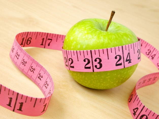 Green apple and yellow measure, healthcare and diet concept