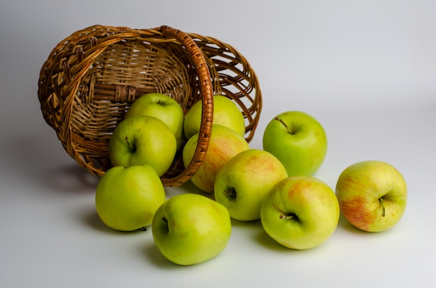 Green apples and a basket.