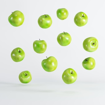 Green apples floating on white background. minimal idea food concept.