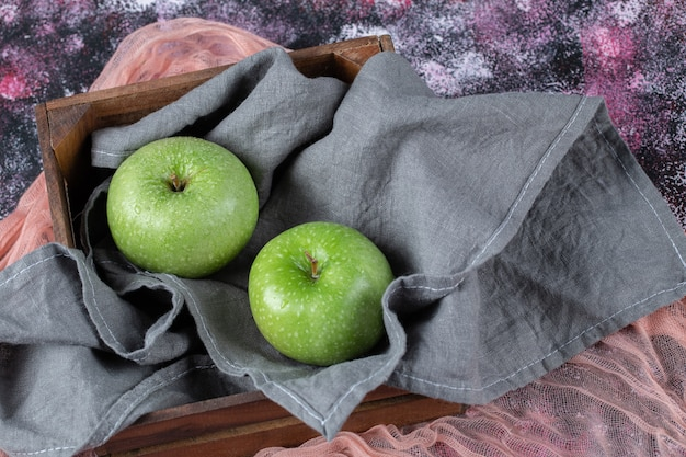 Green apples isolated on the textured surface