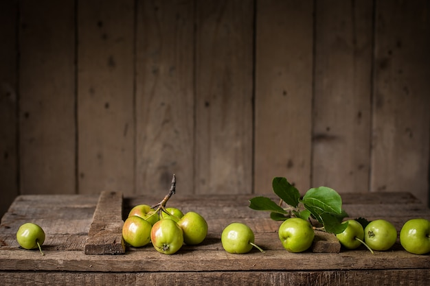 Green apples on an old box