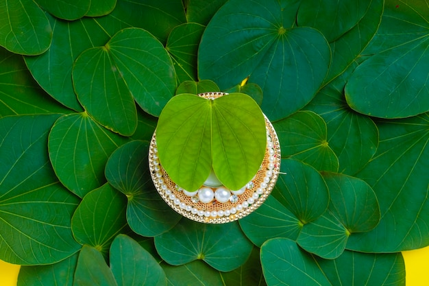 Green apta leaf and rice, indian festival dussehra