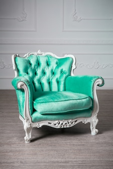 Green armchair in the room