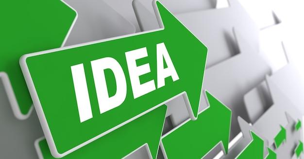 灰色の背景にアイデアテキストと緑の矢印