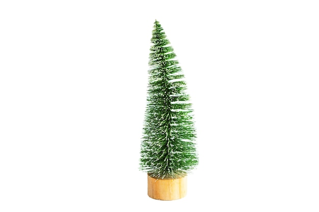 Green artificial christmas tree in the shape of a triangular brush o