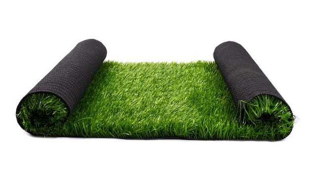 Green artificial grass isolated on white