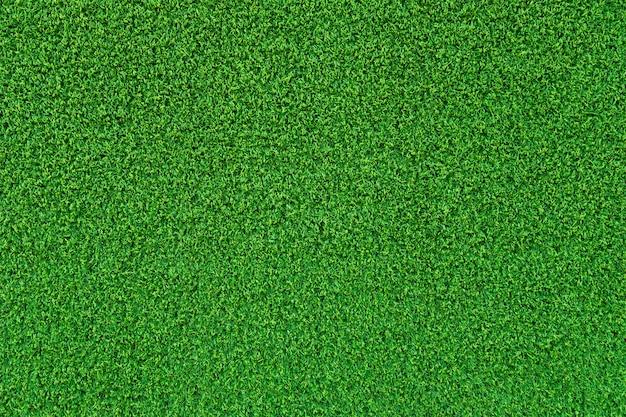 Зеленая искусственная трава поверхности фона текстуры.