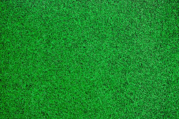 Green artificial grass top view background.