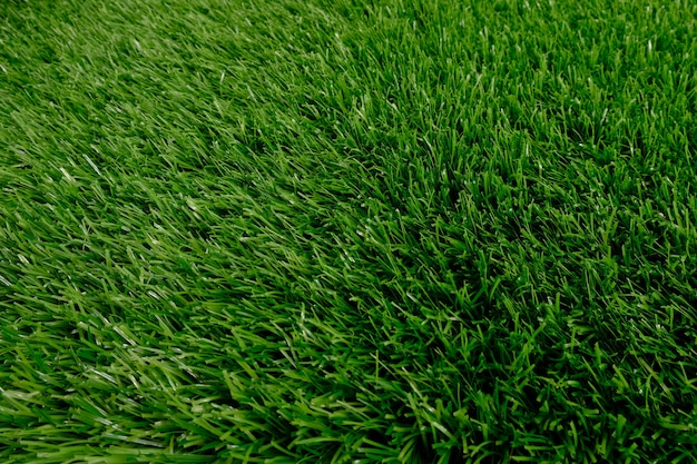 Green artificial grass top view. floor covering. background, copy space.