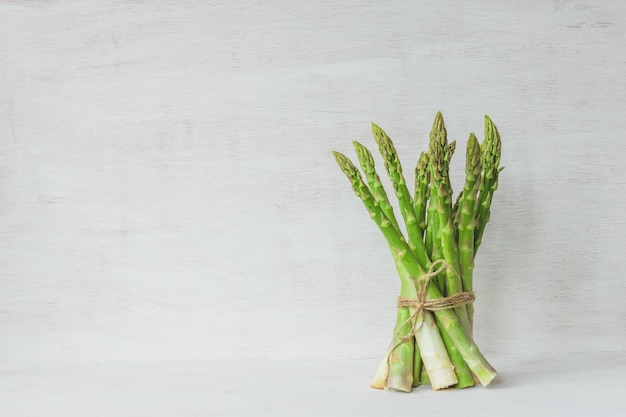 Green asparagus bundle on white