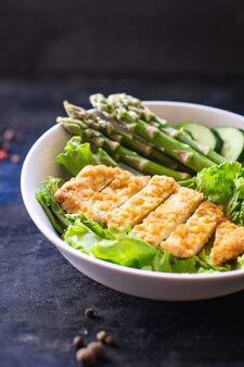 Green asparagus salad chicken meat bowl greens salad leaves eating organic diet on the table