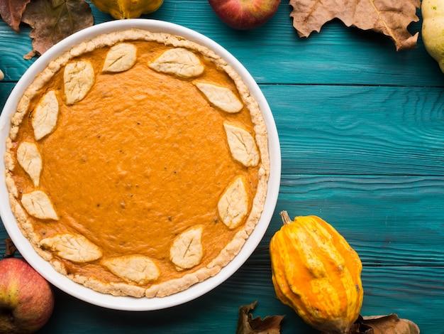 Green autumn with pumpkin pie