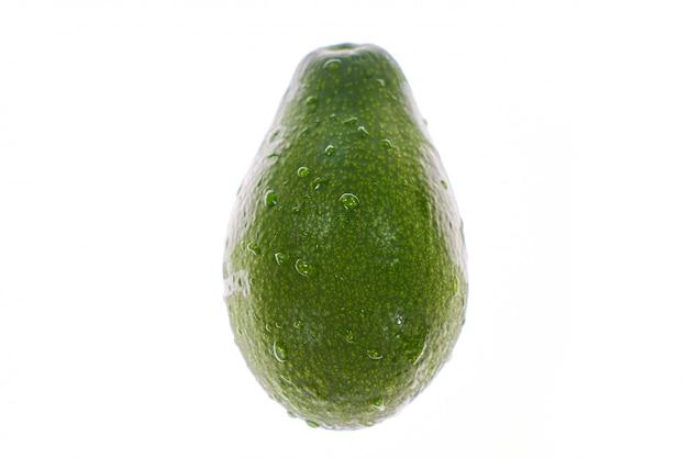 Green avakado on a white background