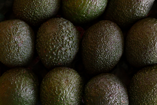 Green avocado vegetables table, top view, close up