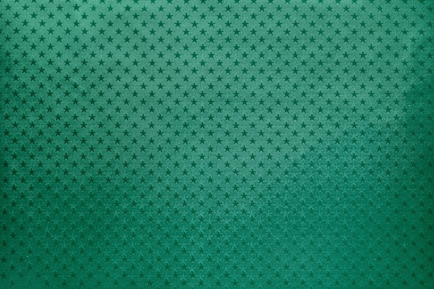 Green background from metal foil paper with a stars pattern