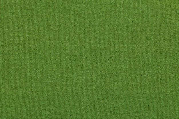 Green background from a textile material with pattern, closeup. structure of the fabric with natural texture.