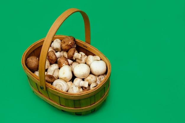 Green background mushrooms basket brown champignon