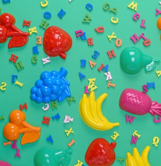 Green background with childrens plastic toys