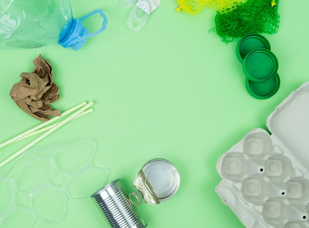 Green background with garbage objects for recycling. copy space.