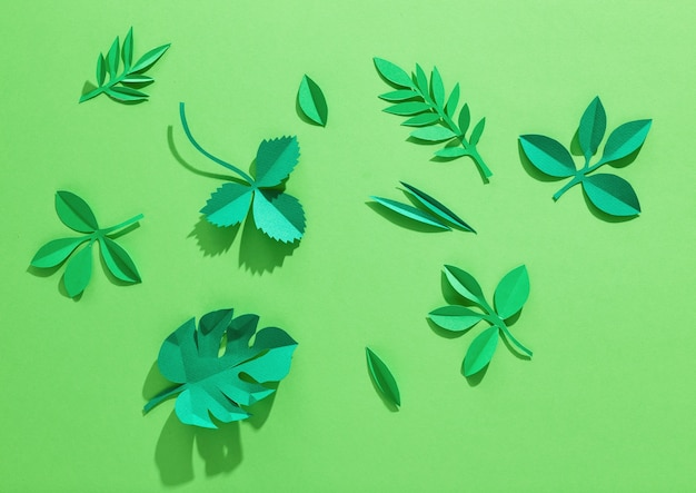 Green background with paper leaves