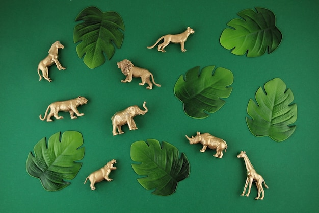 Green background with tropical leaves and exotic animals