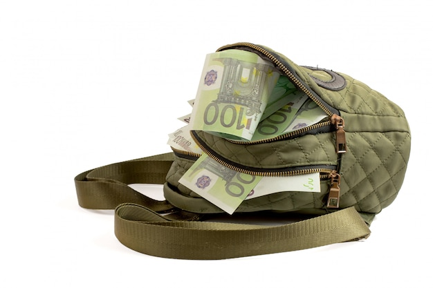 Green backpack with euro banknotes on white