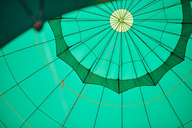 Green balloon from the inside with ropes