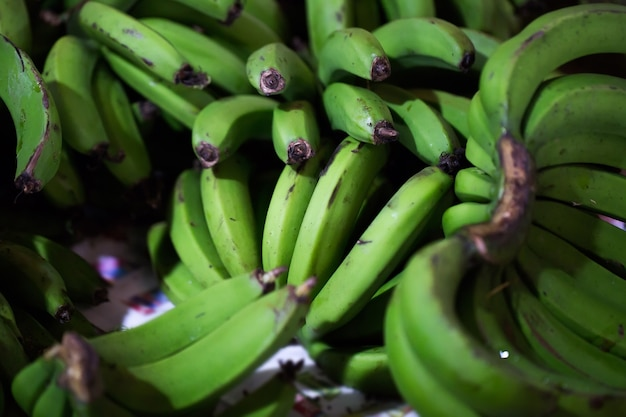 Green bananas in the indian market in mauritius