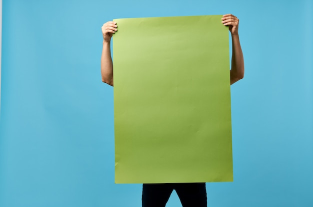 Green banner in the hands of a man mockup information copy space marketing