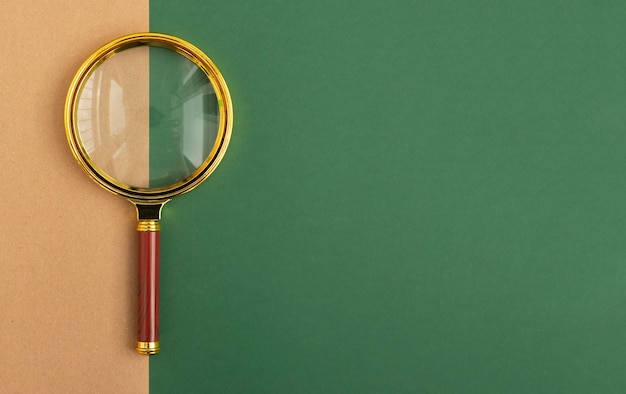Green banner with copy space and golden magnifying glass