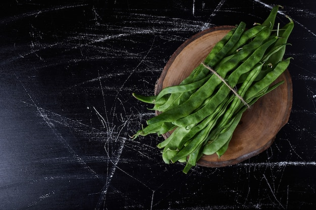 Green beans on black
