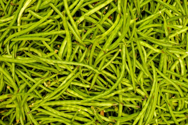 Green beans close up top view. food background